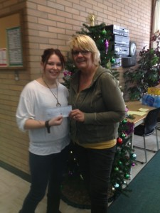 "Jasper Williams from Alexandra Middle School ""My Place""  receiving a $300 cheque from President Sharon Stolz for Christmas Hampers"